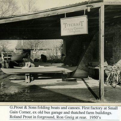 G.Prout & Sons folding boats & Canoes. This shows the first factory at Smallgains Corner, an old Bus Garage and thatched farm building (Smallgains Farm). Roland Prout in the foreground, Ron Greig at the rear. 1950's | Ian Hawks