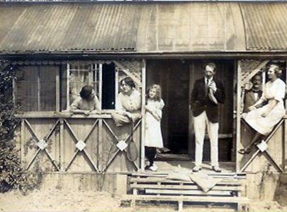The Mulleys on holiday in front of their bungalow. Paul and Elsie Smyth are on the far right.   Courtesy of Barbara Pearce
