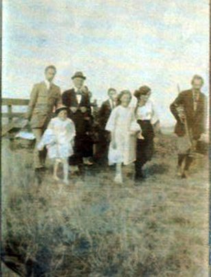 The Mulley family on Canvey. A grab-shot of the joys and adrenaline of rushing to a holiday on unmade roads, but dressed for the occasion. | Courtesy of Barbara Pearce