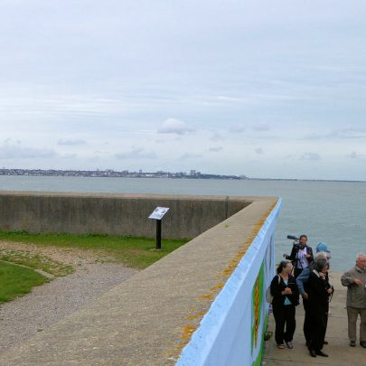 Showing the location of the information board and the mural with the Heavenly Body II crash site beyond. In the far distance is Southend Pier. | Janet Penn