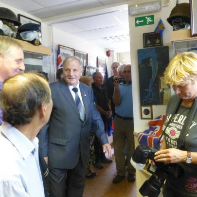 Dave Thorndike addresses the people squeezed into the tiny museum | Janet Penn