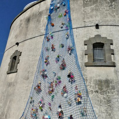 Tower showing the flower art installation all made from plastic bottles and other plastic waste | Janet Penn