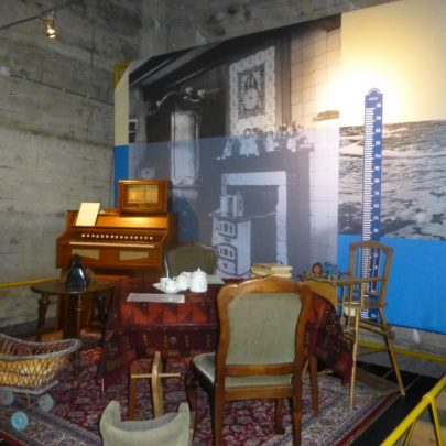 Showing a typical living room at the time and the height of the flood water | Janet Penn