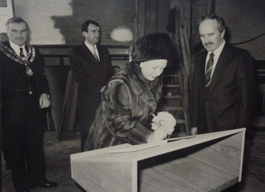 Princess Margaret signs the visitors book at Prouts with CPDC Chairman Peter Woods looks on | Jeff Nevett