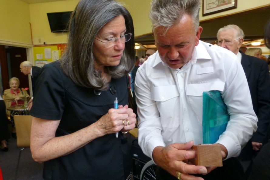 Barbara being given a keepsake from the crashsite by Gary Foulger | janet Penn