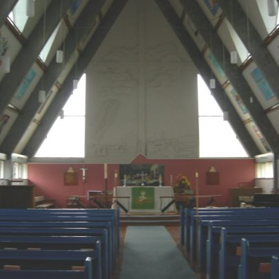 The Altar and redesigned East window showing Canvey buildings, the seawall, shipping and a large cross surmounted by storm clouds   Janet Penn