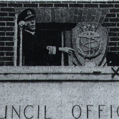 Exchange of plaques on the balcony of the Council Offices, Long Road, Canvey. Chairman of the Council Edward Rayment on the left next to Vice Admiral Snagg C.V.O   Chalky White