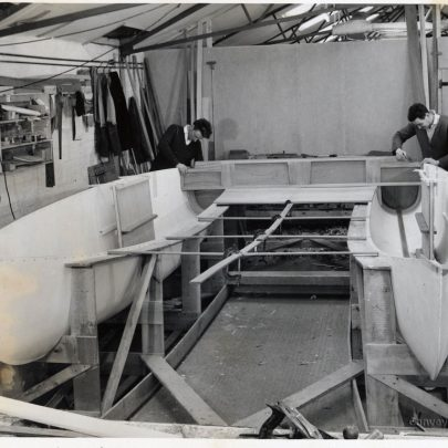 Fitting the mainsheet support beam to the cockpit (Don left Wally right) | Don Rayner