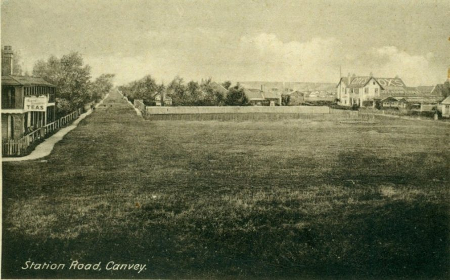 Grass covered Station Road. Marlborough House on the left, Cox's to the right. The large grass area is still there.