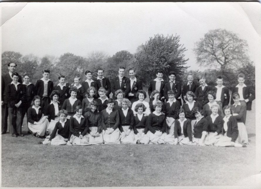 This photo was taken at King Johns playing field in Thundersley was for the music festival probably 1957/ 1958. In the back row Alan Goodfellow, Paul Selby, David Holloway, Tommy Nichols, Keith Bonsor,  ?, ?, ?, ?, ?, ?, ?, ?, ?, ?, ?   Middle row ?, ?, ?, ?, ?, Cherry Morton, Helen Bishop, ?, ?, ?, Pat Carmen, Sheila Saul. Front row Linda Bamfield, Kathleen Sorrell, Me Helen Barnes,  ?,  Sylvia Howard, ?, ?, Jenny Stevens, ?, ?, ? | Helen Thurlow