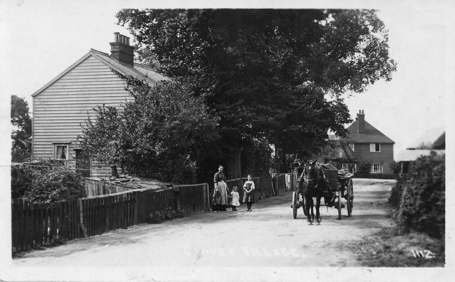 View of Canvey Village from Long Road, there were two more pairs of cottages laying back behind the fence in the foreground - Lin's father was born in one of these | Michael and Lin Swanson