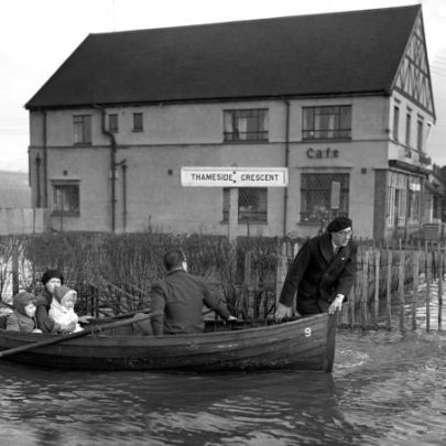 Ray Howard's mother, brother and sister in the boat far left. The man doing the rowing is Ernie Etherington and the man in the beret is Bill Beaver. 1953