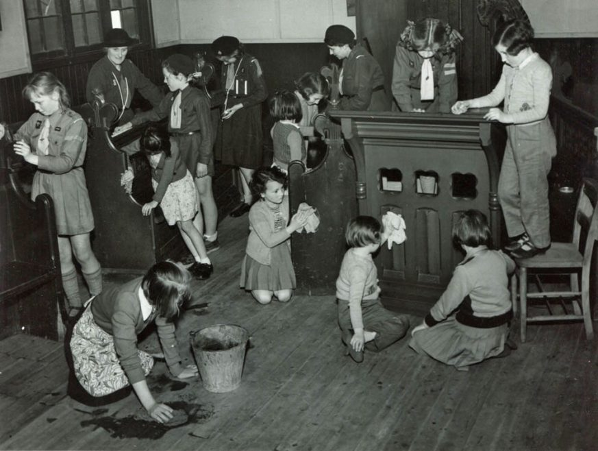 This is a great picture of the inside of St Anne's Church with the Guides and Brownies helping to clean-up after the floods of 1953 | Phyllis Owens