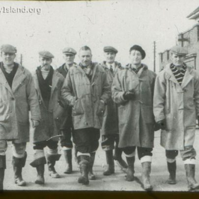 Outside the Council Offices. Definitely council staff. Could be Reg Stevens 3rd from left. LOOKS LIKE THEY GOT A FREE ISSUE OF DUFFEL COATS. | Norman Chisman