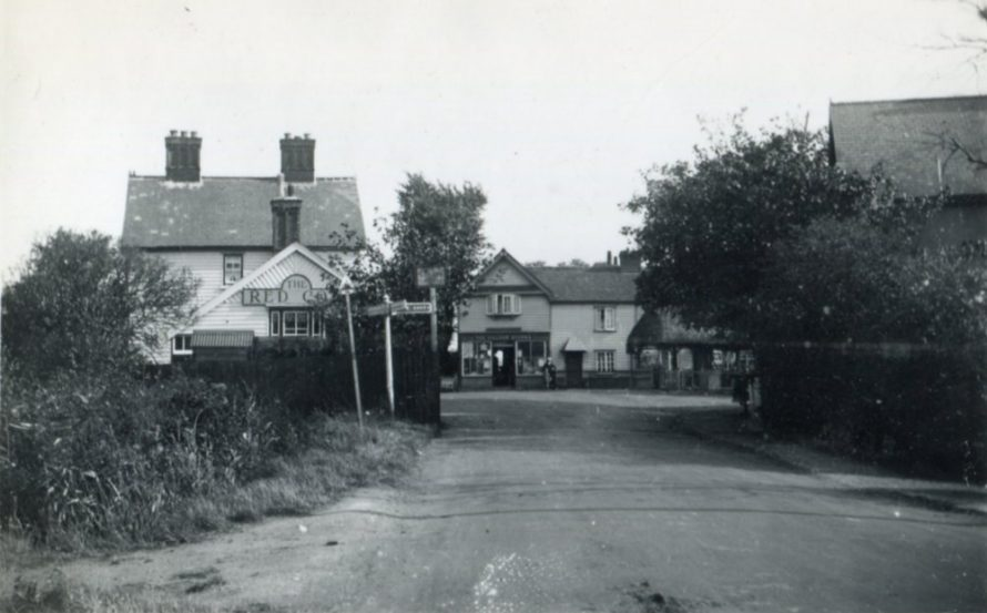 Entrance to the village from the West with the Red Cow on the left, the pump can just be seen on the right and the building right in the middle is the one still standing today   Henry Clubb