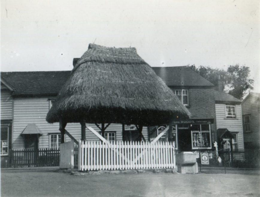 The village pump with Haven Road to the right. The shop to the right is George Woods place   Henry Clubb