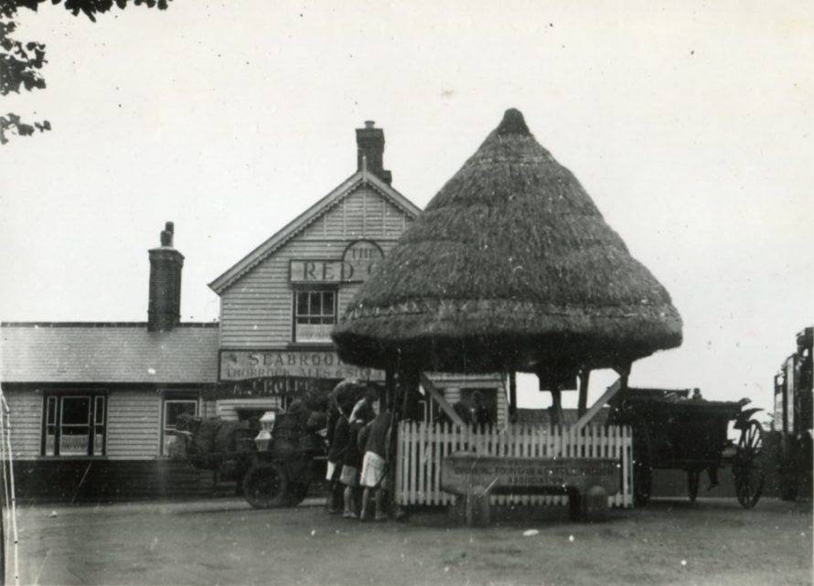 The pump looking North from Haven Rd with The Red Cow behind   Henry Clubb