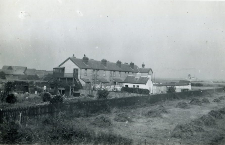 The Coastguards cottages. To the left is Sluice Farm and in the distance is the pumping station   Henry Clubb