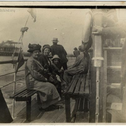 Winnie and family on a boat, possibly approaching Southend Pier